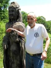 Man posing next to Kwan Yin. The statue was acquired by Zen Peacemakes and may return to Montague Retreat Center once an appropriate spot is prepared for her.