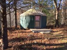 The (16' diameter) yurt. It's unfurnished, but there's power for heat (and for blowing up air mattresses).