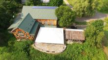 View of the barn and reception tent from above.